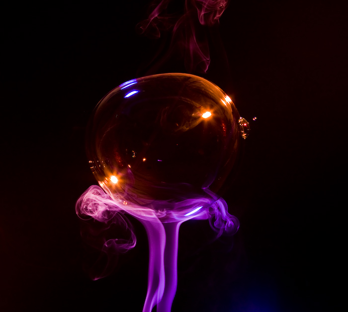 Soap bubble on top of Colored Smoke