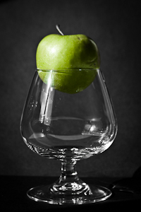 Glass with green apple