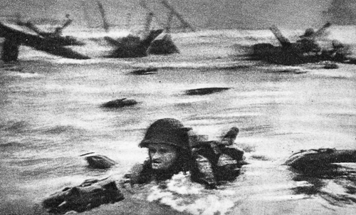Robert Capa. FRANCE. Normandy. June 6th, 1944. Landing of the American troops on Omaha Beach.