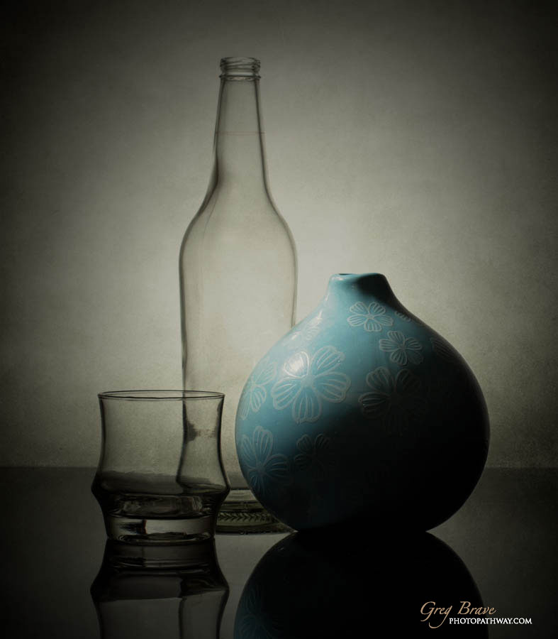 Still life with bottle and vase in color by greg brave