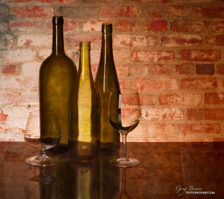 Still life with bottles and glasses in color by greg brave