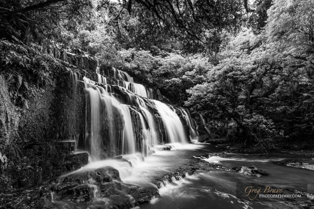 Purakaunui cascades waterfall in black and white, Catlins, South Island, New Zealand | Photo Pathway