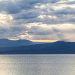 Sun rays shining through clouds near Bruny Island, Tasmania, Australia