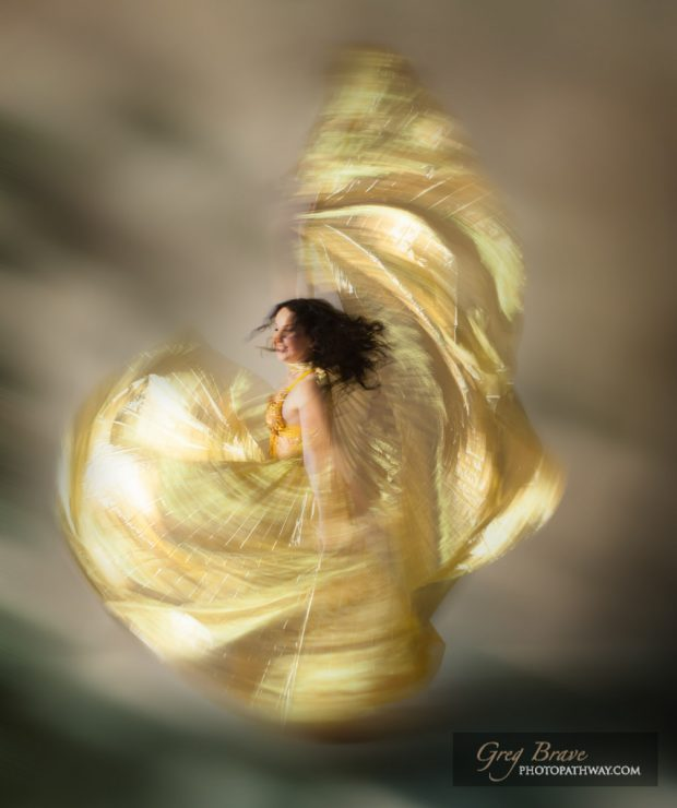 Ethereal beautiful woman swirling in a dance move