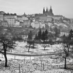 Winter in Prague - snow, bare trees and St. Vitus Cathedral in the distance