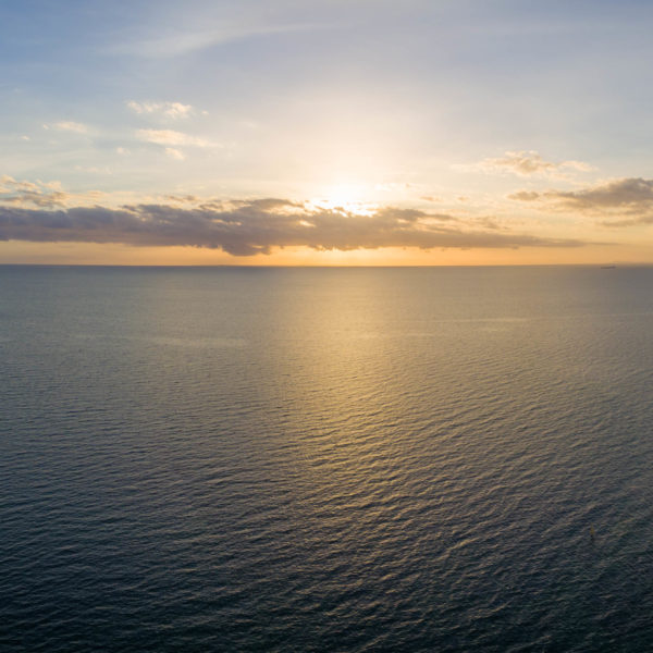 Aerial view of sunset over ocean