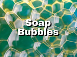 soap bubbles against glass - macro image