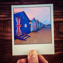 Hand holding photograph of famous Brighton Beach Boxes in Melbou