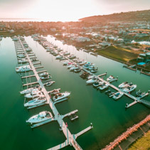 Aerial view of Safety Beach suburb and marina at sunset. Mornington Peninsula, Melbourne Australia