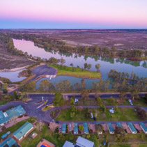 Aerial landscape of Murray River flowing through the town of Berri at dusk. Riverland region of South Australia