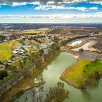 Holiday park cabins on shores of Murray River in Berri, South Australia - aerial view