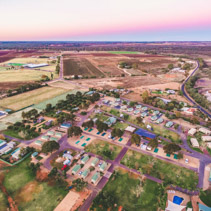 Aerial landscape of holiday park on shore of Murray River at dusk in Berri, South Australia