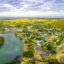Aerial panorama of small coastal town and ocean coastline in Australia