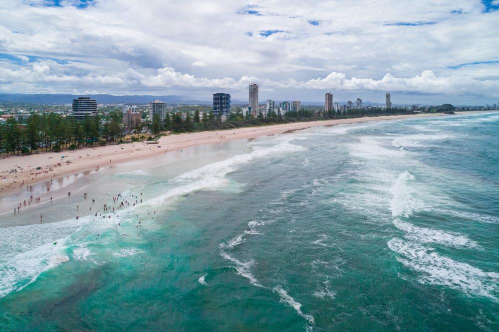 People swimming in the ocean at Burleigh Heads, Queensland, Australia