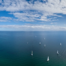 Aerial panorama of many sailboats sailing in Port Phillip Bay on Mornington Peninsula. Melbourne, Victoria, Australia