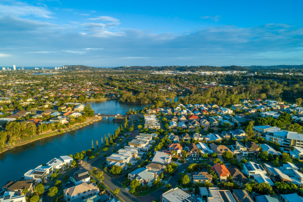 Aerial landscape of Varsity Lakes suburb and Reedy Creek at sunset. Gold Coast, Queensland, Australia