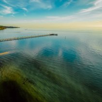 Aerial view of long wooden pier at sunset in Frankston, Victoria, Australia