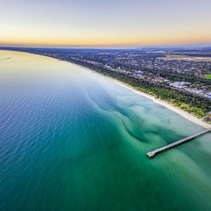 Aerial panorama of beautiful ocean coastline beaches and suburbs