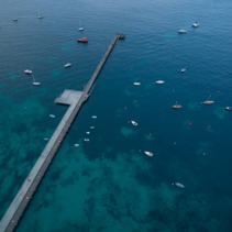 Aerial view of Flinders pier with moored fishing boats at dusk, Mornington Peninsula, Melbourne, Victoria, Australia
