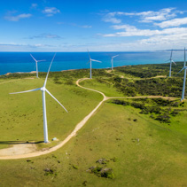 Aerial panorama of wind farm in rural area on bright sunny day in Australia