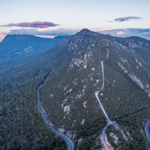 Aerial panorama of Mount Roland Regional Reserve and Olivers road at sunset. Mount Roland, Tasmania, Australia