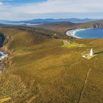 Aerial view of South Bruny National Park and Lighthouse at sunset. Bruny Island, Tasmania, Australia