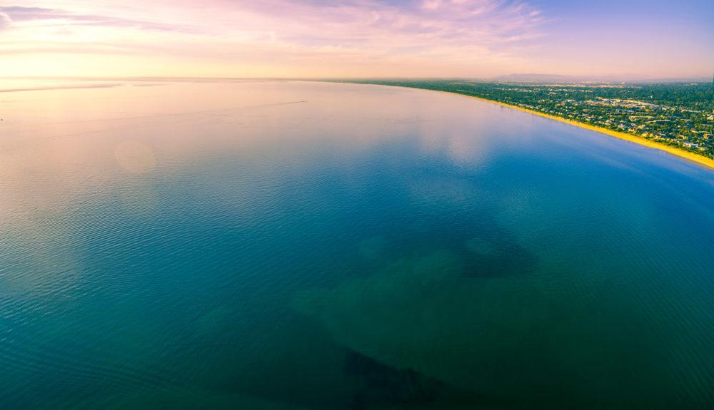 Beautiful minimalist aerial panorama of sunset over Port Phillip Bay in Melbourne, Australia