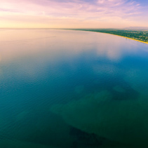 Beautiful minimalist aerial panorama of sunset over Port Phillip Bay in Melbourne, Australia