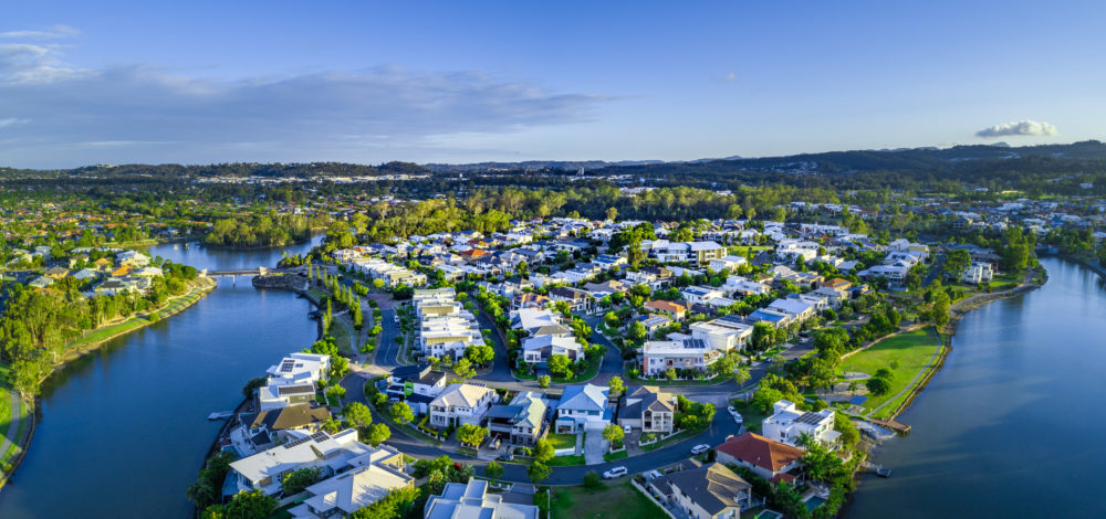 Aerial panorama of Reedy creek and luxury houses. Varsity Lakes, Gold Coast, Queensland, Australia