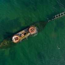 Melbourne, Australia - Dec 20 2016: Looking straight down from the air at historic shipwreck of HMVS Cerberus in shallow turquoise waters. Closeup shot. Melbourne, Victoria, Australia