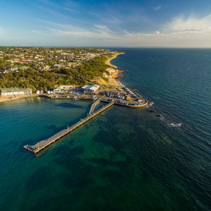 Aerial landscape view of Black Rock suburb pier and yacht club at sunset. Melbourne, Victoria, Australia