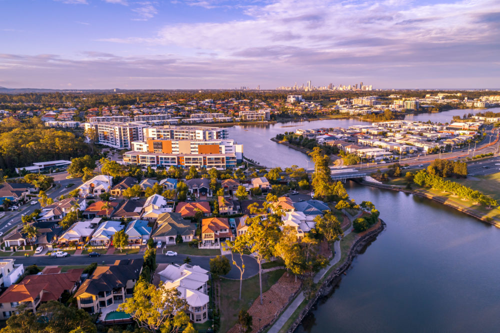 Varsity Lakes suburb luxury real estate at sunset. Gold Coast, Queensland, Australia - aerial landscape