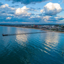 Aerial view of Frankston Pier and waterfront at sunset. Melbourne, Australia