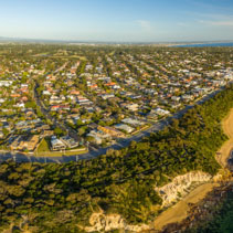 Aerial panorama of Black Rock suburb in Melbourne at sunset. Port Phillip Bay coastline, Victoria, Australia