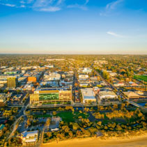 Aerial view of Frankston suburb and South East Water building at sunset