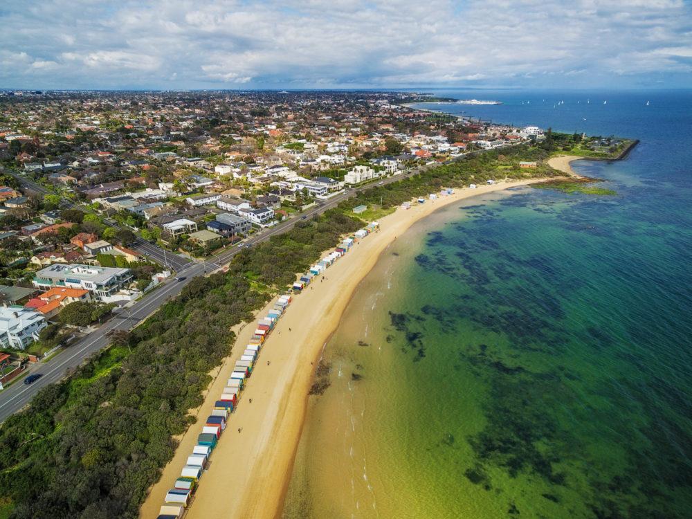 Aerial view of Brighton Beach boxes on a bright sunny day. Melbourne, Victoria, Australia
