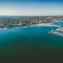Aerial panorama of Middle Brighton Marina, coastline, and suburban area. Melbourne, Australia