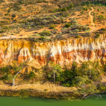 Colorful layers of sandstone erosion over Murray River near Berri, South Australia