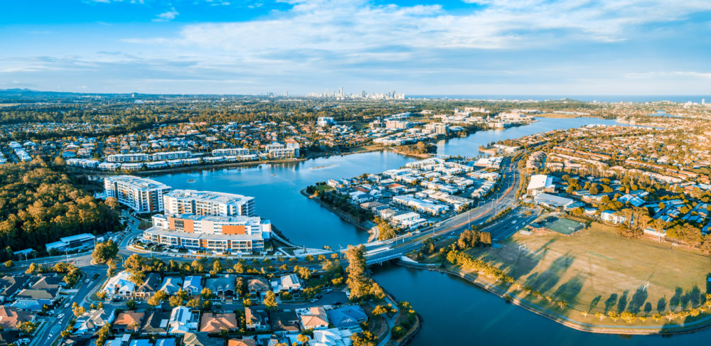 Varsity Lakes suburb luxury real estate at sunset. Gold Coast, Queensland, Australia - aerial panorama