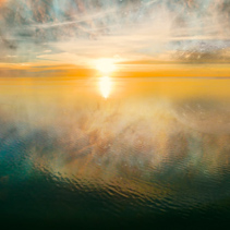 Unreal fantasy landscape sunset over calm water with clouds and alien planet reflections. Elements of this image are furnished by NASA