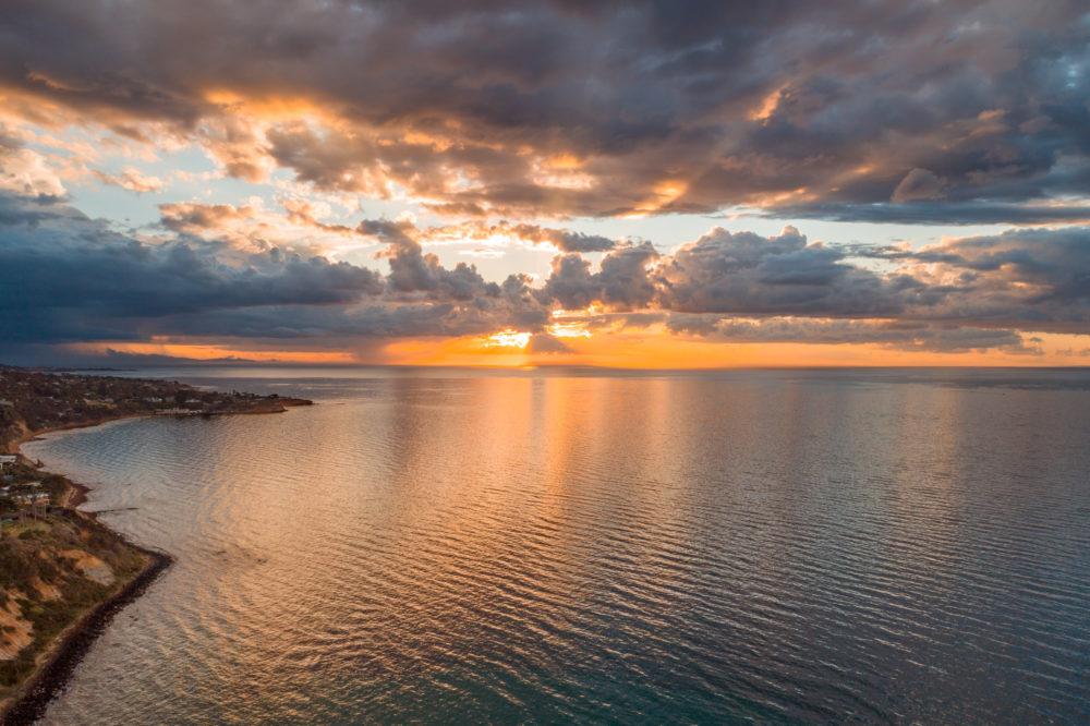 Glowing orange sunset over Port Phillip Bay near Mornington Peninsula coastline