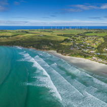 Aerial panorama of Cape Bridgewater beach, settlement, and wind farm in Victoria, Australia