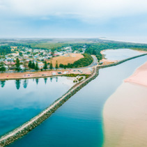 Aerial panorama of Harrington breakwall and Manning river mouth. Harrington, New South Wales, Australia