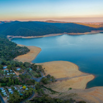 Aerial panoramic landscape of Lake Burrinjuck and holiday park at sunset. NSW, Australia