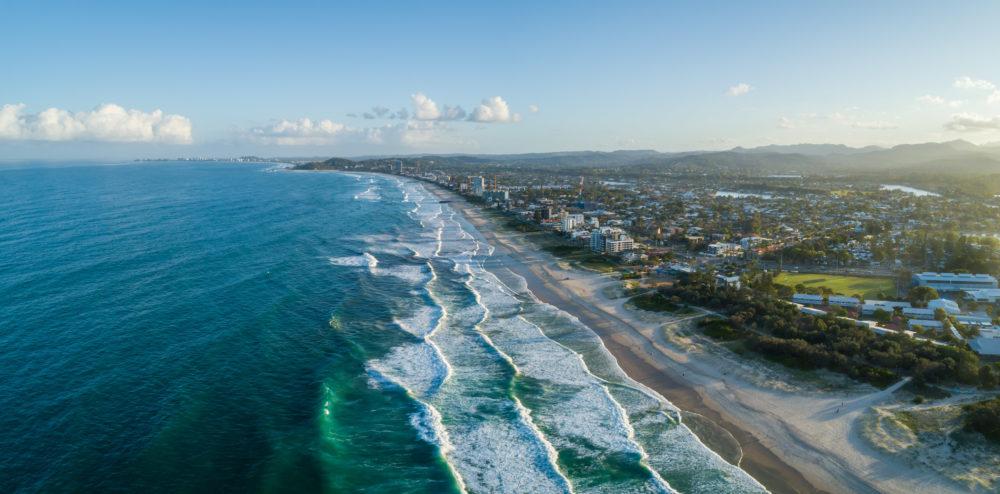 Aerial panorama of Palm Beach suburb and ocean coastline at sunset. Gold Coast, Queensland, Australia