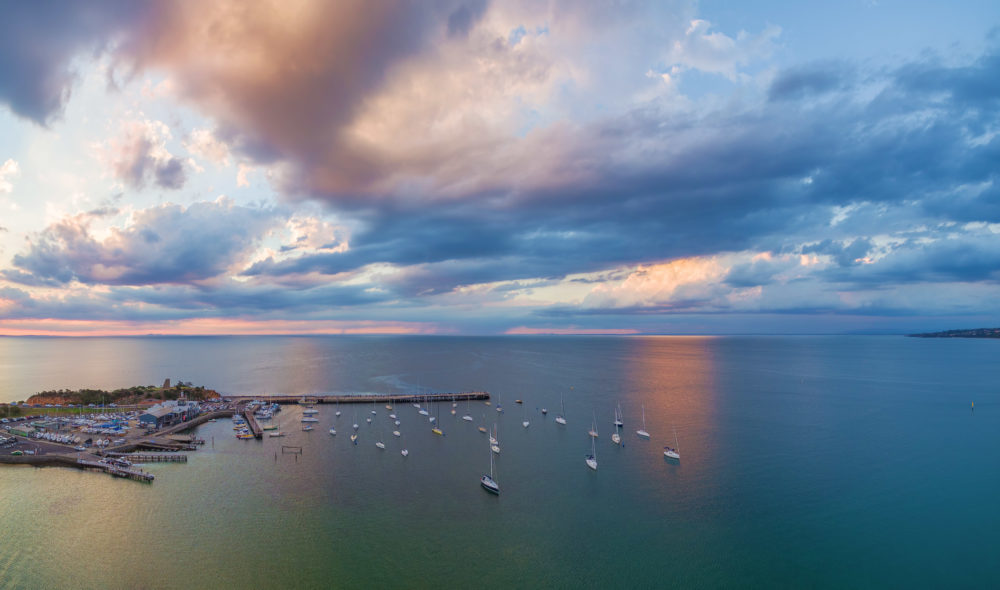 Cloudy sunset over Mornington pier and yachts in Australia