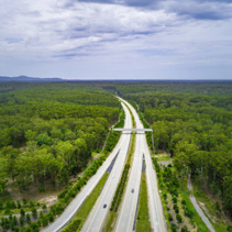 Aerial view of highway passing through Australian countryside in New South Wales, Australia