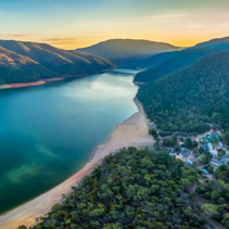 Aerial panoramic view of lake Burrinjuck and forested hills at sunset in Australia
