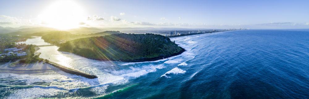 Wide aerial panorama of Gold Coast coastline at sunset.