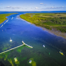 Aerial panoramic view of Warneet pier, mangroves, and ocean inlet. Melbourne Victoria, Australia.